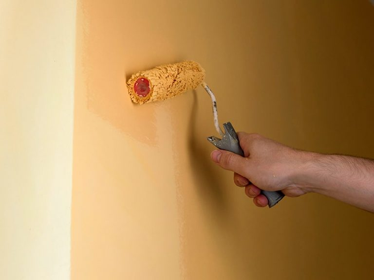 Painting a Wall with Yellow paint on Brisbane